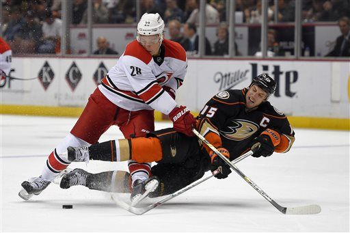 Anaheim Ducks center Ryan Getzlaf, right, tangles with Carolina Hurricanes right wing Alexander Semin, of Russia, as he tries to pass the puck during the second period of an NHL hockey game, Tuesday, Feb. 3, 2015, in Anaheim, Calif.