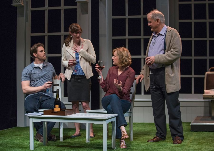 "Financial adviser Ray (Francis Guinan), right, and his wife, Roz (Mary Beth Fisher), second from right, welcome their ""adopted"" son Christopher (Jordan Brown) and his idealistic fiancee, Molly (Amanda Drinkall), in Bruce Graham's ""White Guy on the Bus,"" an examination of race in its world premiere at Northlight Theatre."