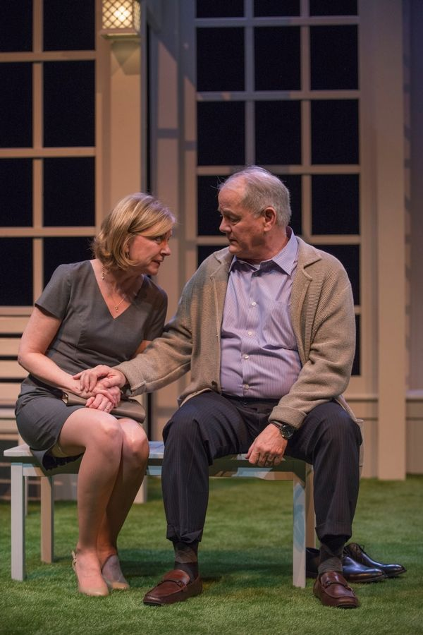 "Roz (Mary Beth Fisher) reassures her husband, Ray (Francis Guinan), the titular ""White Guy on the Bus,"" in Bruce Graham's examination of race in its world premiere at Northlight Theatre."