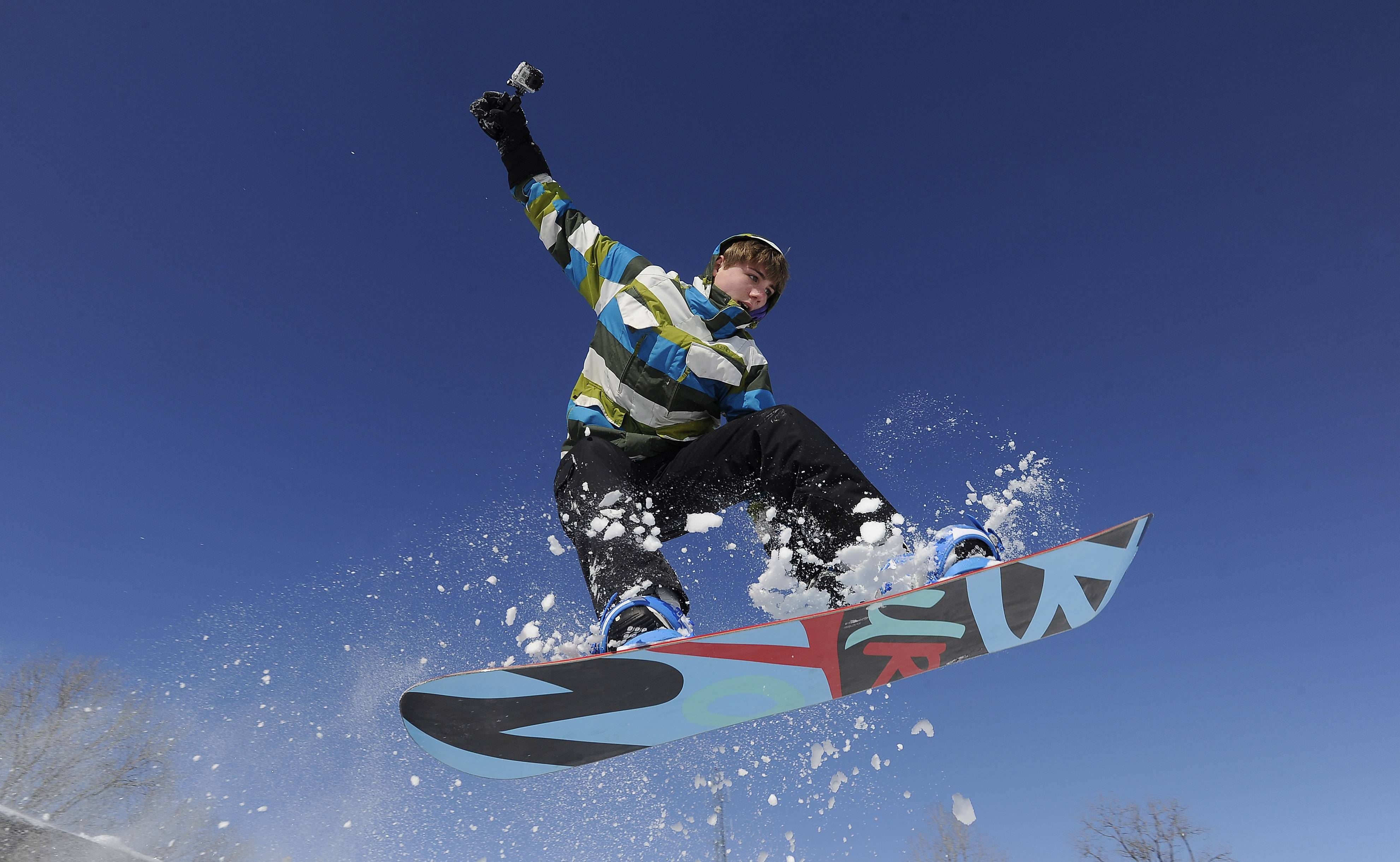 Brandon Ruetche, 14, of Arlington Heights, soars into the blue on fresh powder at Melas Park in Mt. Prospect.