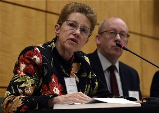 Dr. Ellen Wright Clayton, chair of the Committee on Diagnostic Criteria for Myalgic Encephalomyelitis/Chronic Fatigue Syndrome, left, speaks during an open meeting at the Institute of Medicine in Washington, Tuesday, Feb. 10, 2015. Chronic fatigue syndrome is a real and serious disease that needs a new name to reflect that _ and a straightforward way to diagnose the illness, a government advisory group declares. The new name, Systemic Exertion Intolerance Disease, better reflects the hallmark symptoms of this mysterious illness, namely, that patients can be wiped out by exertion. Committee member Peter Rowe sits at right.