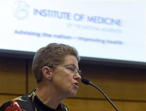 Dr. Ellen Wright Clayton, chair of the Committee on Diagnostic Criteria for Myalgic Encephalomyelitis/Chronic Fatigue Syndrome speaks during an open meeting at the Institute of Medicine in Washington, Tuesday, Feb. 10, 2015. Chronic fatigue syndrome is a real and serious disease that needs a new name to reflect that _ and a straightforward way to diagnose the illness, a government advisory group declares. The new name, Systemic Exertion Intolerance Disease, better reflects the hallmark symptoms of this mysterious illness, namely, that patients can be wiped out by exertion.