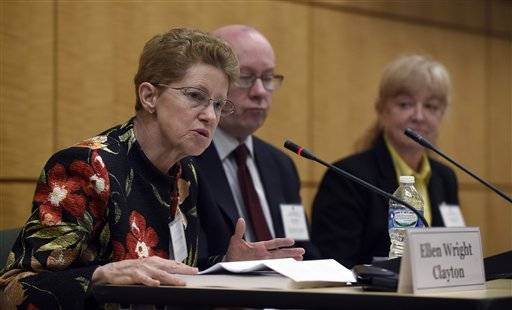 Dr. Ellen Wright Clayton, left, chair of the Committee on Diagnostic Criteria for Myalgic Encephalomyelitis/Chronic Fatigue Syndrome speaks during an open meeting at the Institute of Medicine in Washington, Tuesday, Feb. 10, 2015. Chronic fatigue syndrome is a real and serious disease that needs a new name to reflect that _ and a straightforward way to diagnose the illness, a government advisory group declares. The new name, Systemic Exertion Intolerance Disease, better reflects the hallmark symptoms of this mysterious illness, namely, that patients can be wiped out by exertion. Committee member Peter Rowe, center, and Lucinda Bateman, right, listen.