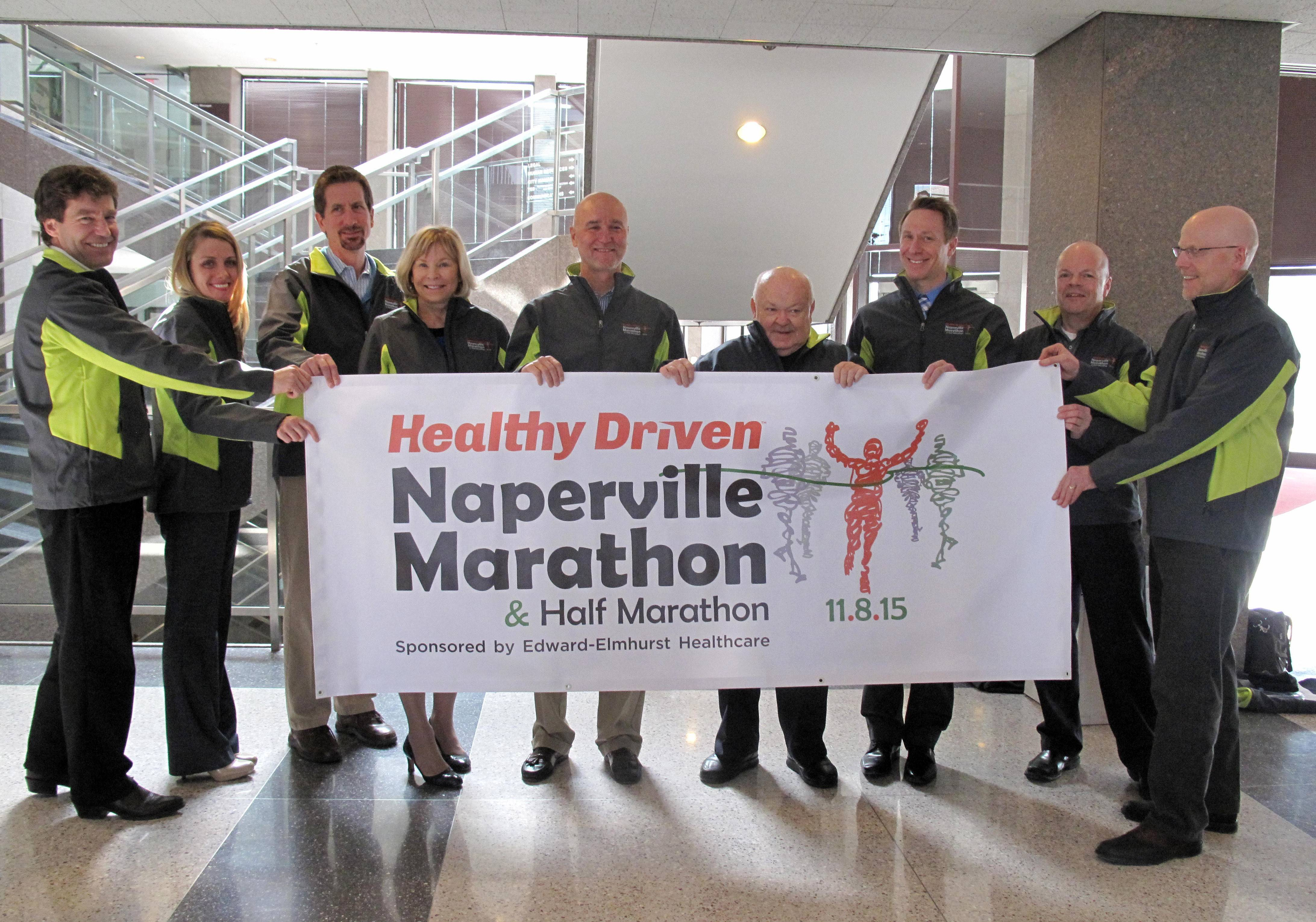 Officials from Naper Events, the city of Naperville and Edward-Elmhurst Healthcare, including Craig Bixler, Meghan Moreno, Doug Krieger, Pam Davis, Dave Sheble, Mayor George Pradel, Dr. Michael Hartmann, Tom Horvath and Brian Davis, introduce the new name for the third annual marathon scheduled for Nov. 8 in Naperville: the Healthy Driven Naperville Marathon and Half Marathon sponsored by Edward-Elmhurst Healthcare.