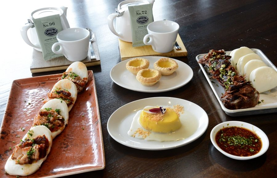 A variety of dim sum selections are available at e+o Food and Drink in Mount Prospect. Among them are Hong Kong style barbecue pork, left, egg tarts, mango pudding, braised beef and bone marrow and tea.