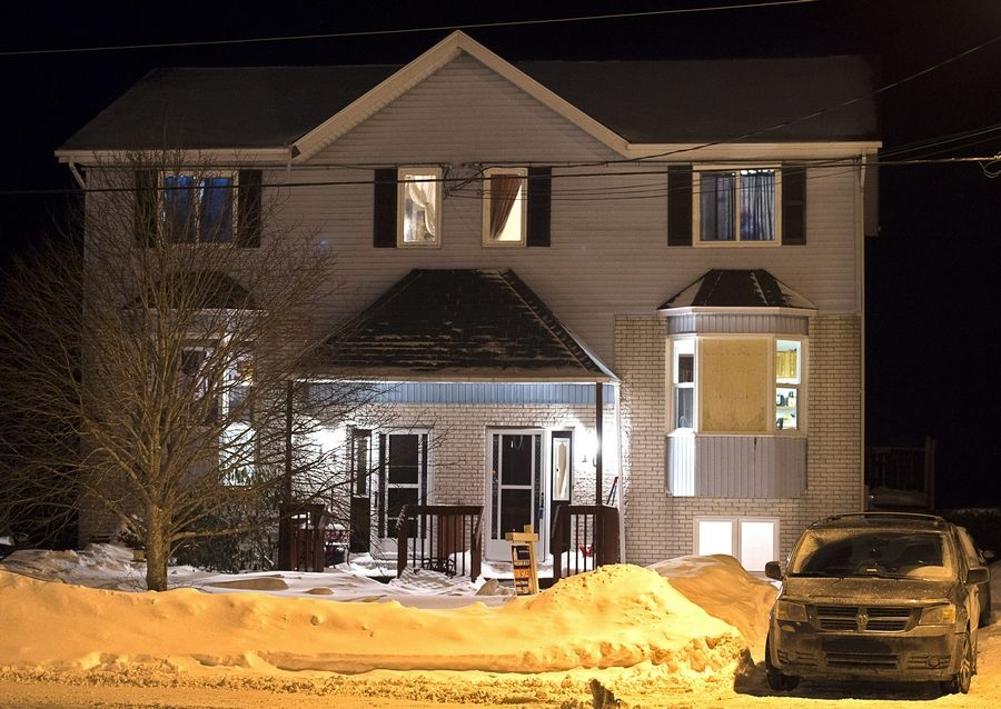 A car is parked outside a home on Tiger Maple Drive in Timberlea, Nova Scotia, a Halifax suburb, where a 19-year-old male suspect shot himself to death after police surrounded his home. A senior police official said Friday police foiled a plot by the man and a 23-year-old Geneva, Illinois, woman to go to a mall and kill as many people as they could before killing themselves on Valentine's Day in Halifax.