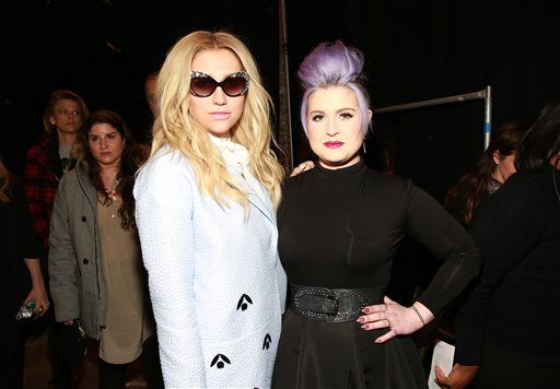 Kesha and Kelly Osbourne pose at the Christian Siriano fashion show at Artbeam on Saturday, Feb. 14, 2015, in New York. (Photo by Amy Sussman/Invision/AP)