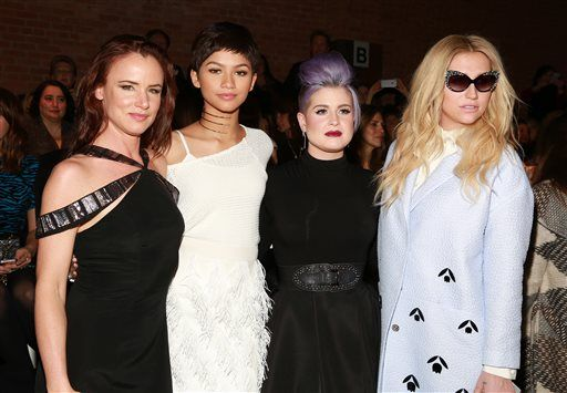 Juliette Lewis, Zendaya Coleman, Kelly Osbourne and Kesha pose at the Christian Siriano fashion show at Artbeam on Saturday, Feb. 14, 2015, in New York. (Photo by Amy Sussman/Invision/AP)