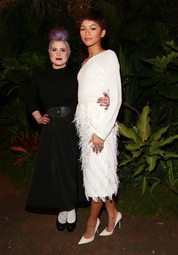 Kelly Osbourne and Zendaya Coleman pose at the Christian Siriano fashion show at Artbeam on Saturday, Feb. 14, 2015, in New York. (Photo by Amy Sussman/Invision/AP)