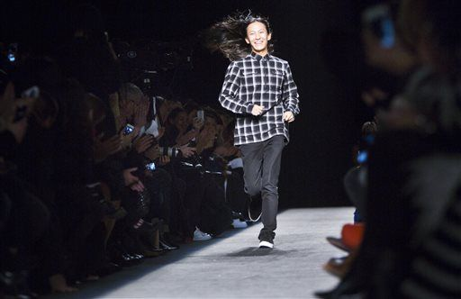 Fashion designer Alexander Wang runs onto the stage to applause after showing his Fall 2015 collection during Fashion Week, Saturday, Feb. 14, 2015, in New York.