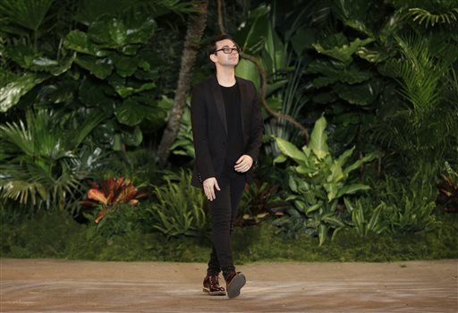 Christian Siriano greets the crowd after his Fall 2015 collection is modeled during Fashion Week in New York, Saturday, Feb. 14, 2015.