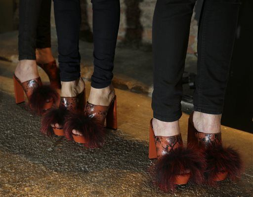 Models wear similar shoes backstage before the Christian Siriano Fall 2015 collection is modeled during Fashion Week in New York, Saturday, Feb. 14, 2015.