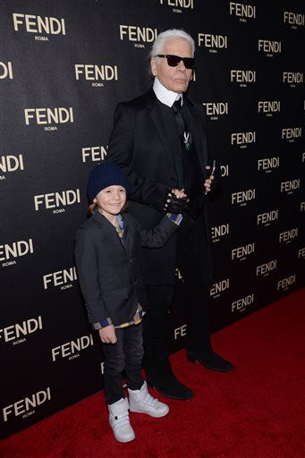 Karl Lagerfeld, right, and Hudson Kroenig attend Fendi's New York Flagship Boutique opening celebration on Friday, Feb. 13, 2015, in New York. (Photo by Evan Agostini/Invision/AP)