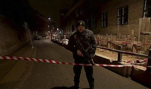 "An armed security officer runs down a street near a venue after shots were fired where an event titled  ""Art, blasphemy and the freedom of expression"" was being held in Copenhagen, Saturday, Feb. 14, 2015. Danish media say several shots have been fired at a cafe in Copenhagen where a meeting about freedom of speech was being held, organized by Swedish artist Lars Vilks, who has faced numerous threats for caricaturing the Prophet Muhammad in 2007. (AP Photo/Polfoto, Kenneth Meyer) DENMARK OUT"