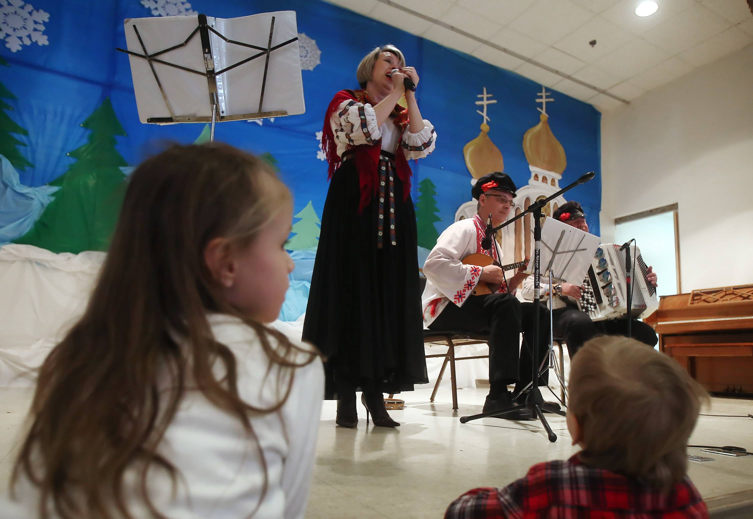 Children watch the Chicago Cossacks perform during the sixth annual Russian Winter Festival Sunday at the Holy Virgin Protection Russian Orthodox Cathedral in Des Plaines. The festival featured old-country traditions, folk music and traditional Russian foods and vodka.