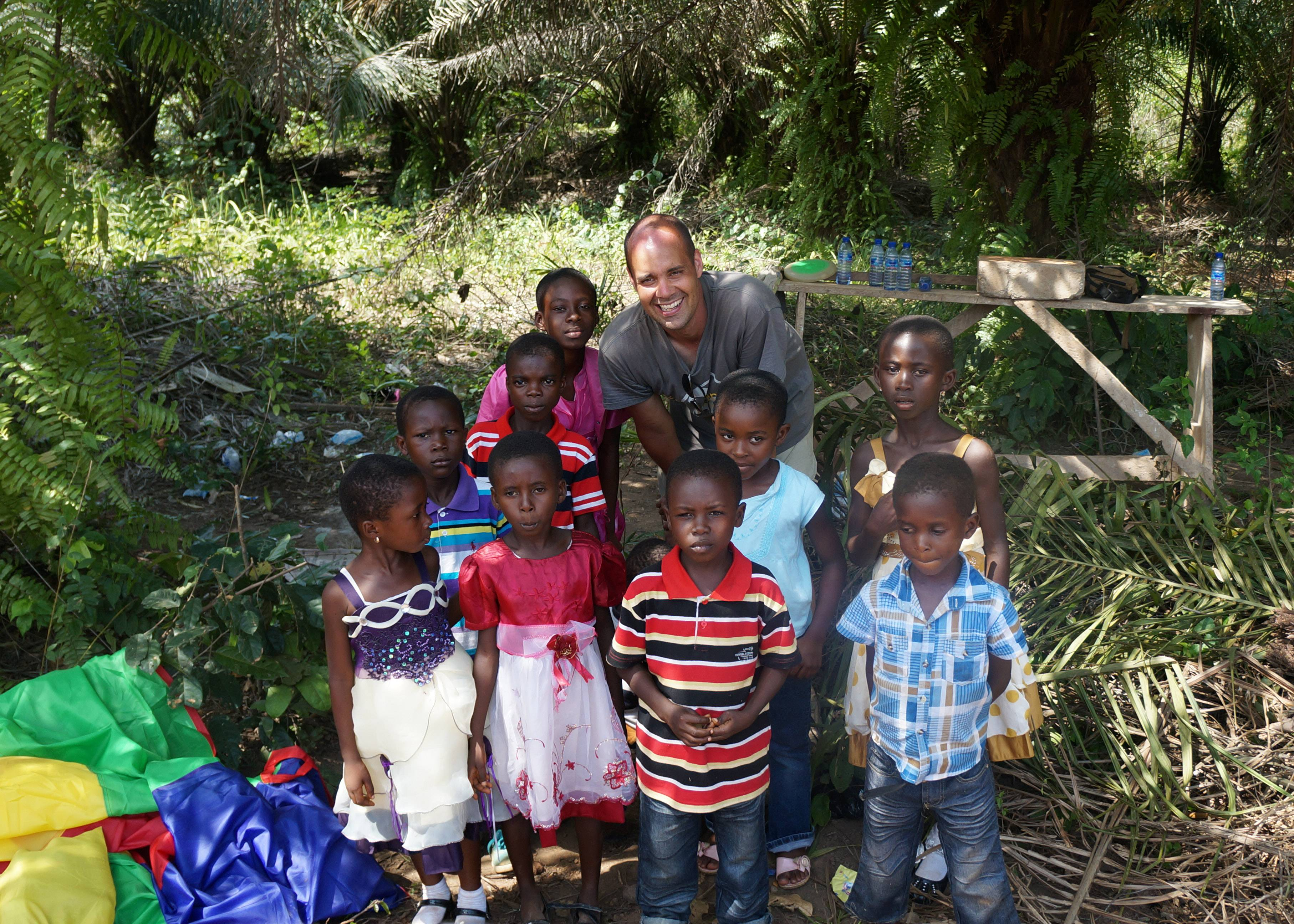 James Reed is pictured with children of the Love and Care Foundation Orphanage in March 2014.