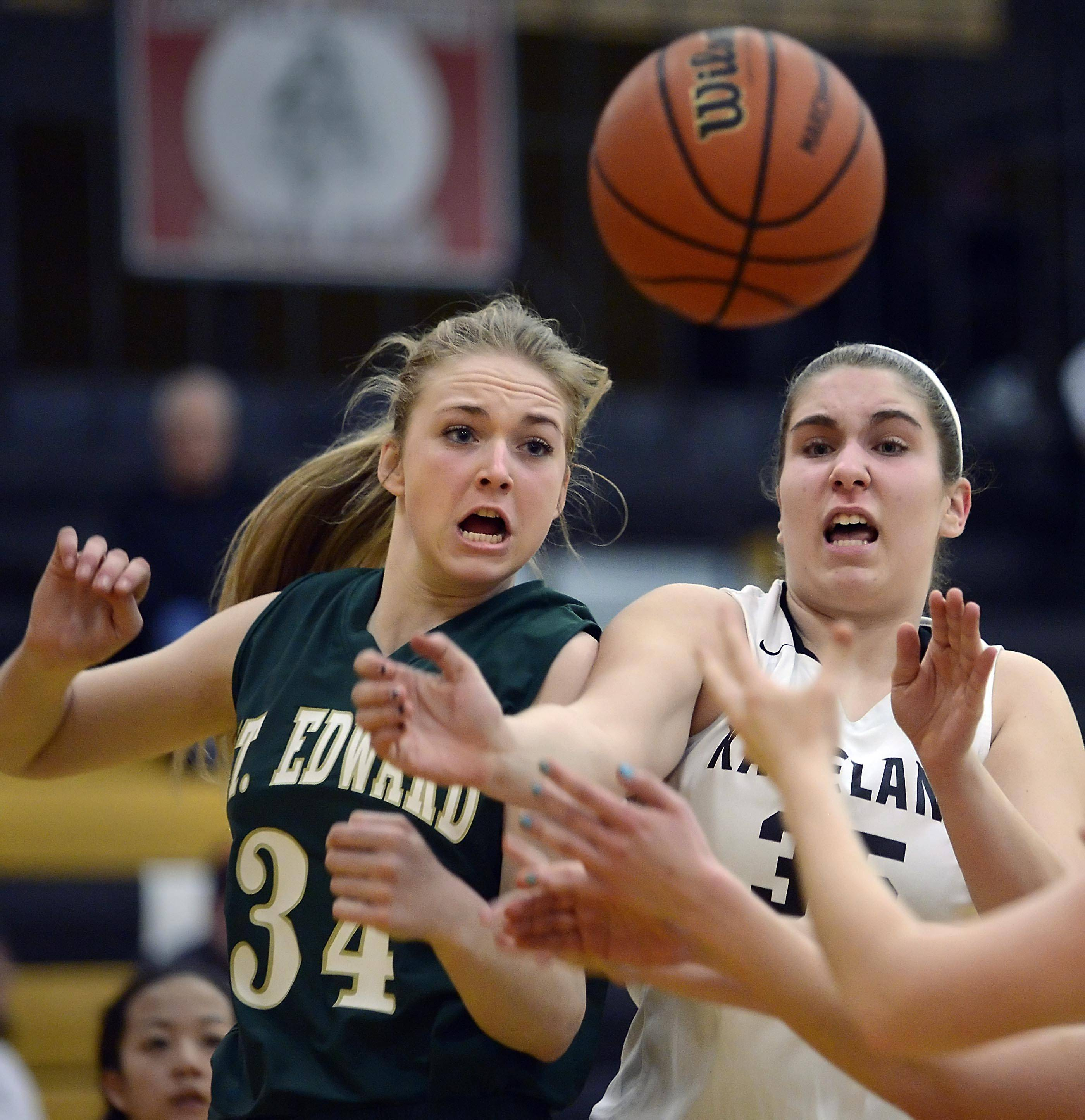 St. Edward's Cece Rapp and Kaneland's Bailey Crimmins fight for a rebound late in the game Monday in the Class 3A Sycamore regional.