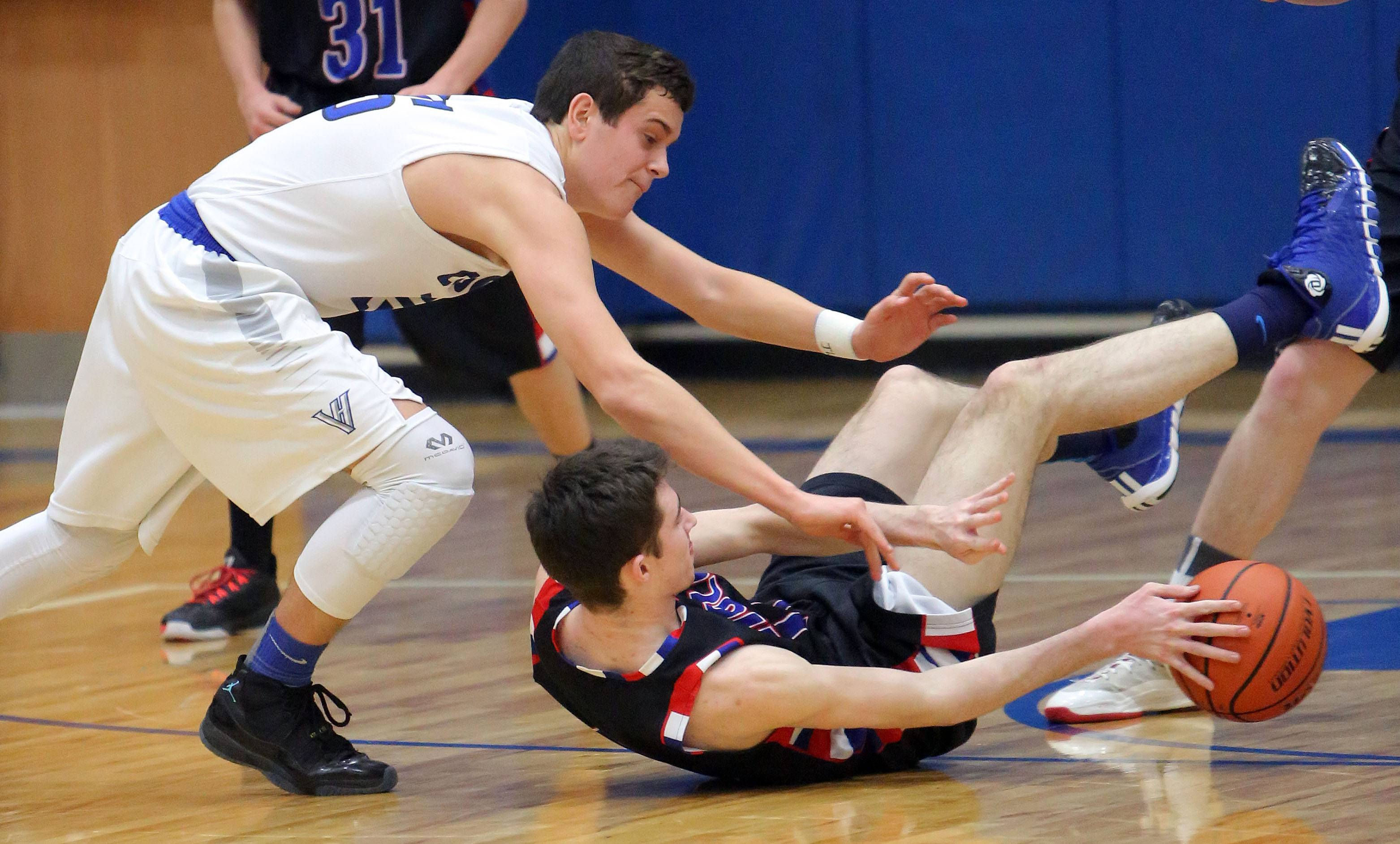 Vernon Hills' Bo Manso, left, and Lake's Jordan Mercure scramble for a loose ball.