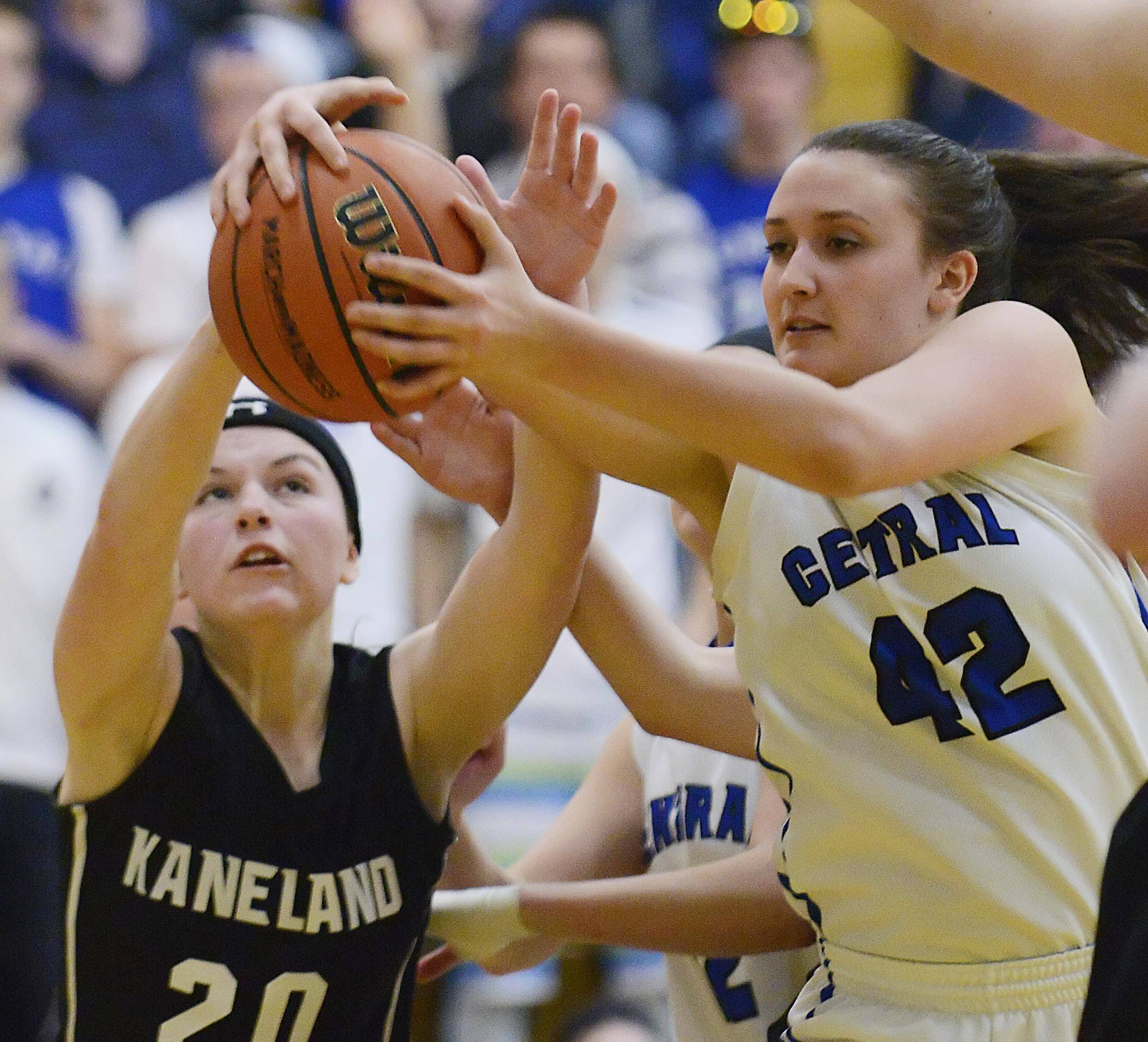 Kaneland's Morgan Weber and Burlington Central's Alison Colby reach for a rebound.