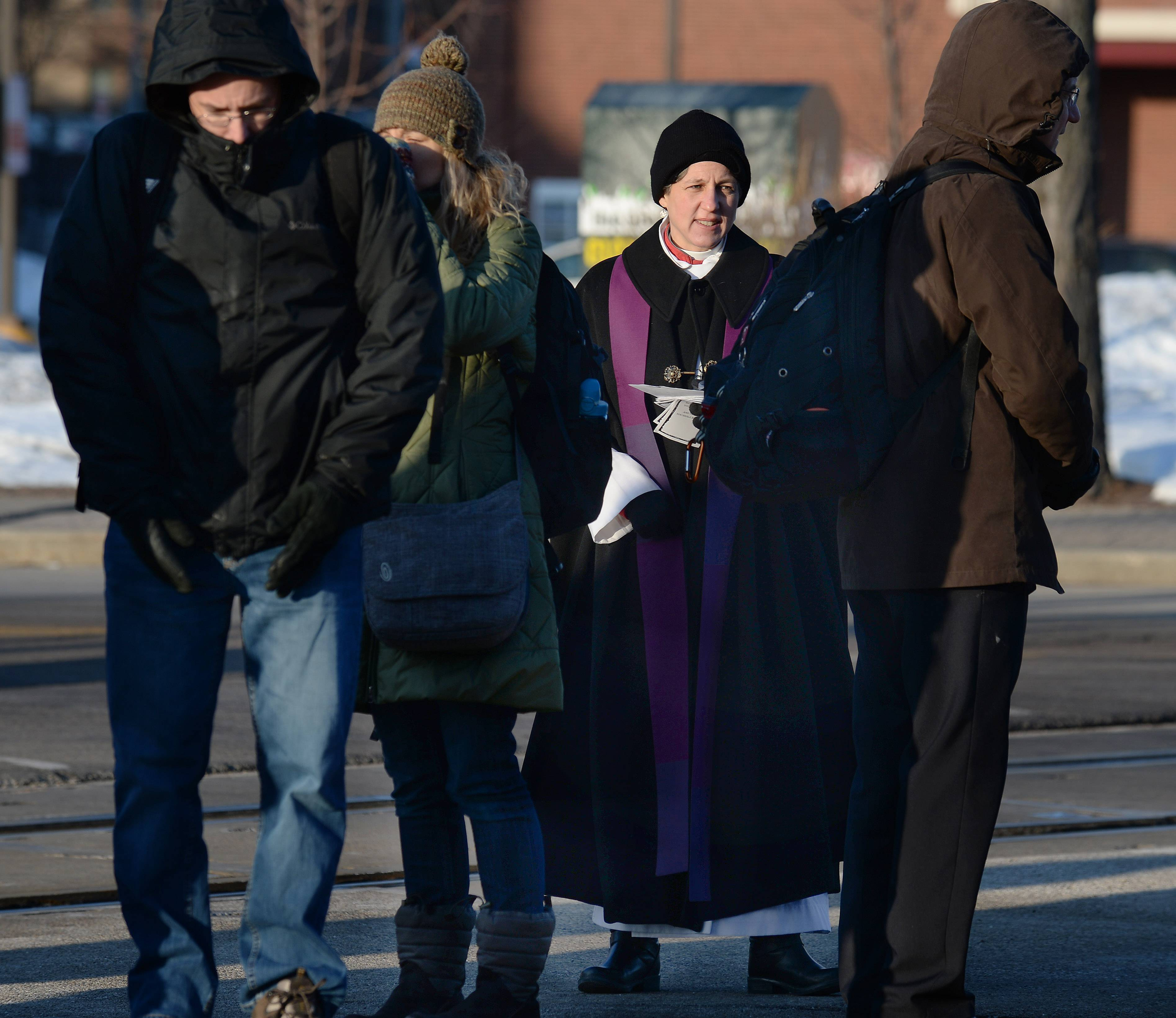 The Rev. Elizabeth Butler Jameson of St. Simon's Episcopal Church in Arlington Heights wore her clerical vestments on Ash Wednesday morning at the Arlington Heights Metra station.