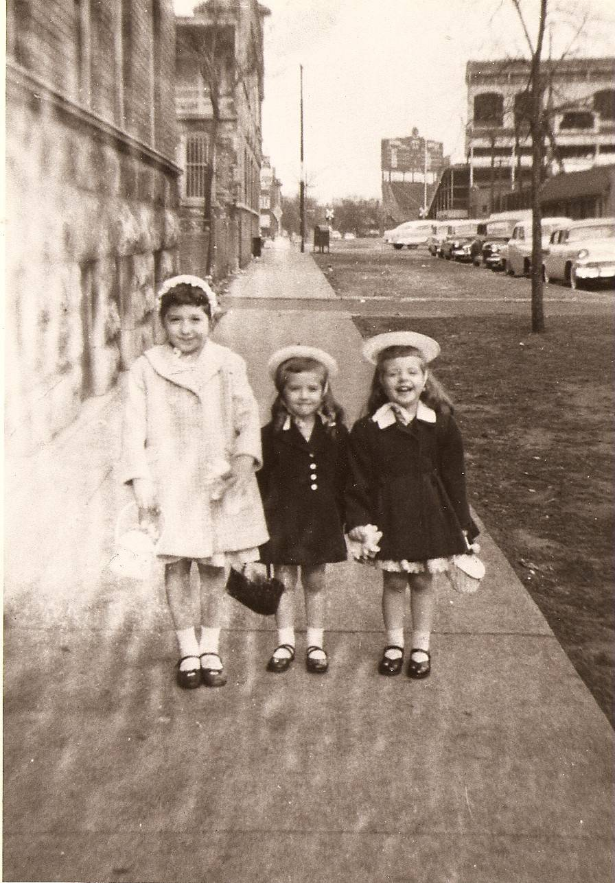 As a kid going to Cubs games, Roger Bain probably walked by the Kool-Aid stand run by his future wife, Linda, left, shown her posing for a photo on Easter in 1959 near Wrigley Field with cousins Maureen and Cindy. Roger and Linda Bain now live in Arlington Heights.