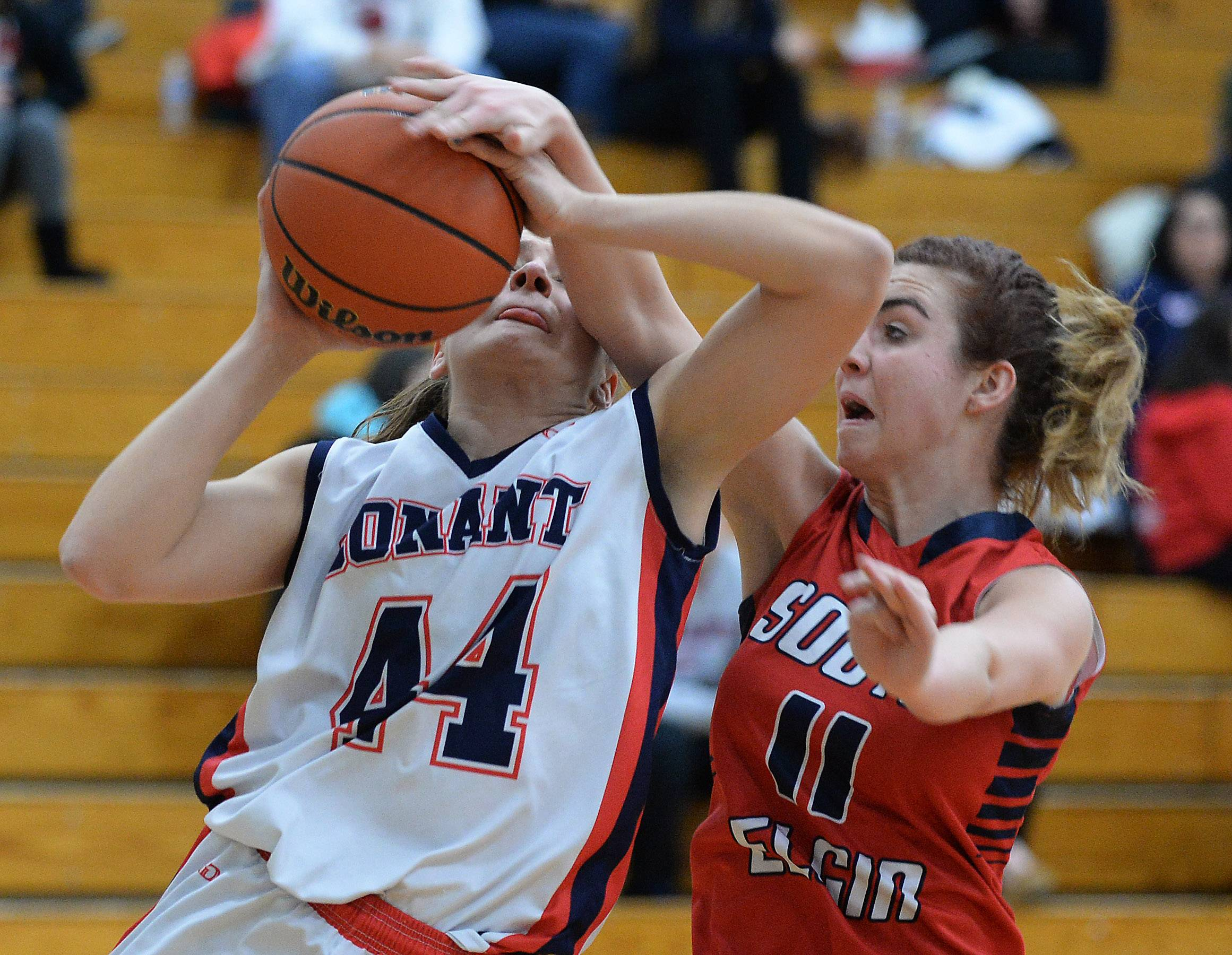 Conant's Jorie Wachal is fouled by South Elgin's Delaney Kelleher.