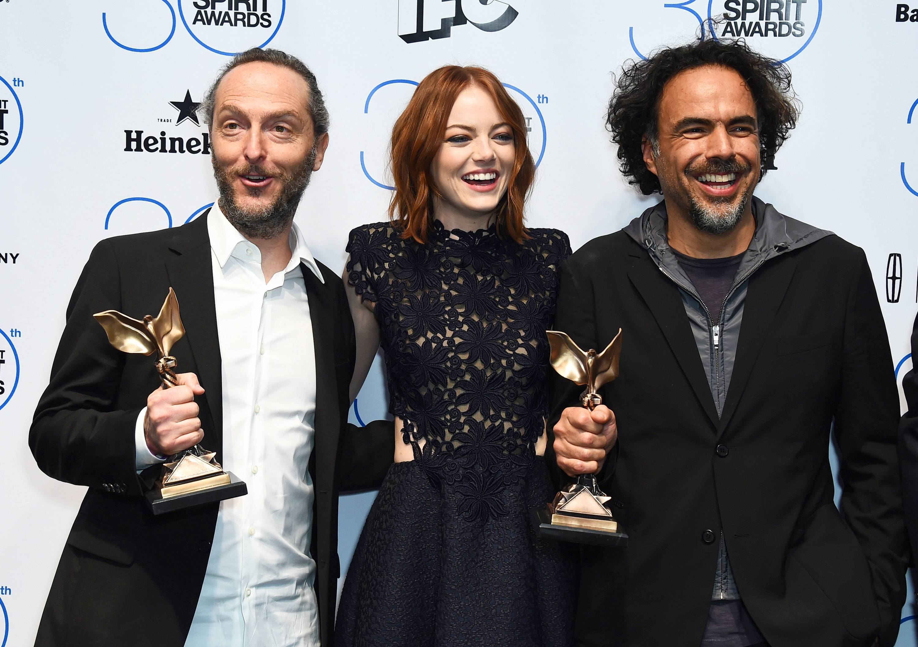 "Emmanuel Lubezki, from left, Emma Stone, and Alejandro Gonzalez Inarritu pose in the press room with the award for best feature for ""Birdman"" or (The Unexpected Virtue of Ignorance) at the 30th Film Independent Spirit Awards on Saturday, Feb. 21, 2015, in Santa Monica, Calif."