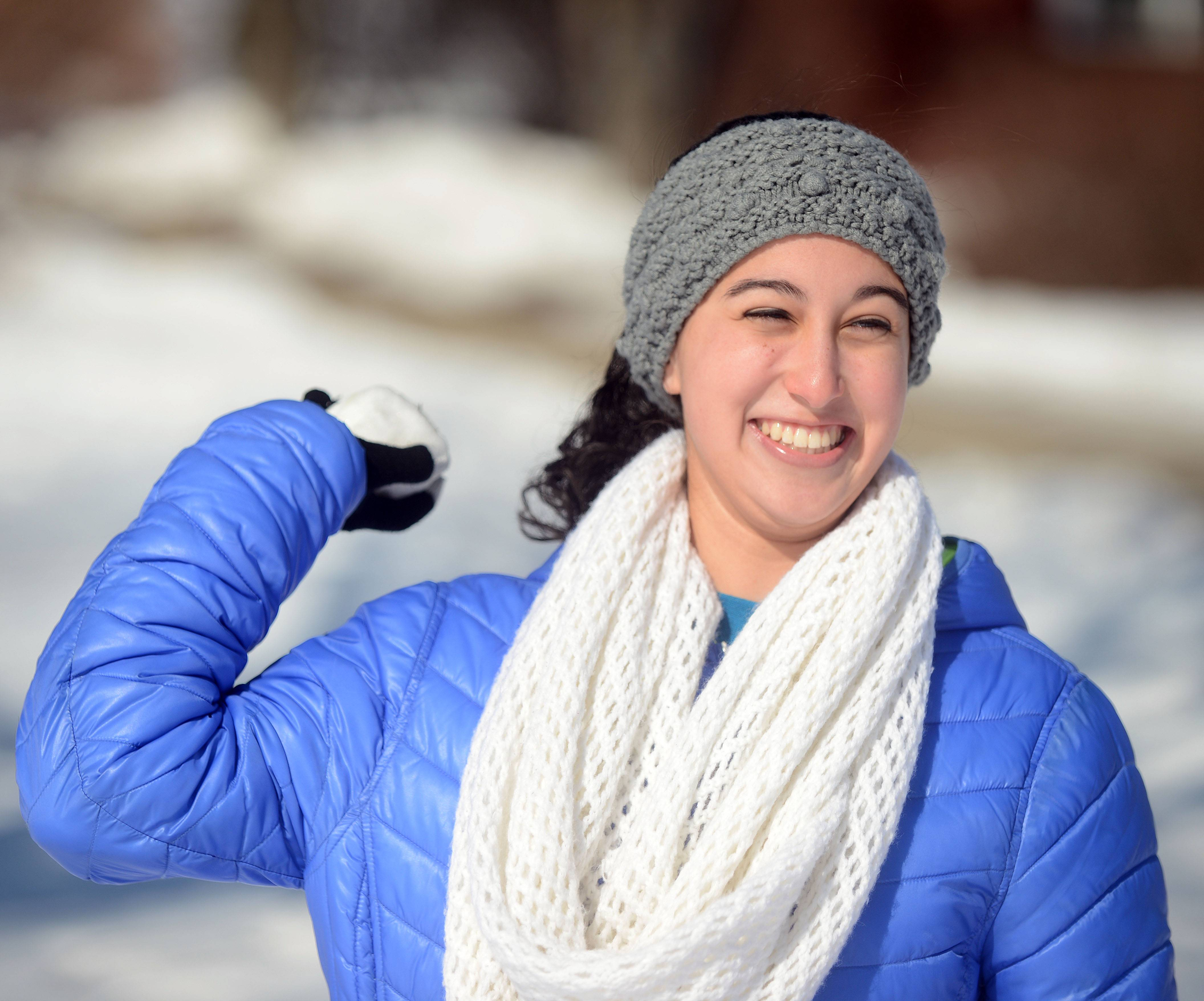 Emily Maruyama, 16, of Glen Ellyn, plays the snowball toss game during the Arctic Blast at Lake Ellyn in Glen Ellyn Sunday. Ice skating and sled races, snowball toss, snow art, hot chocolate and roasted marshmallows for sale were all part of the fun.