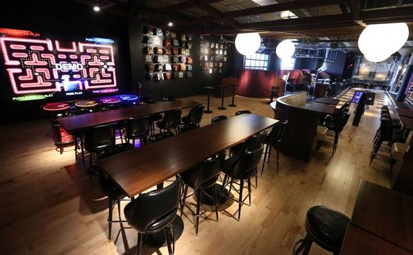 PacManthemed Restaurant Opens At Woodfield - Restaurant table games