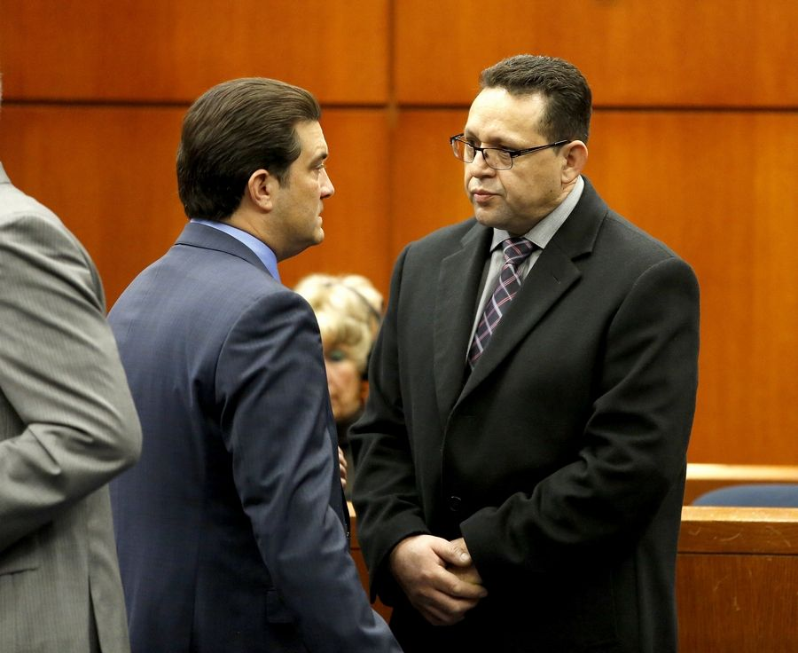 Truck driver Renato Velasquez, right, with Attorney Steven Goldman, pleaded not guilty to several charges in March 2014. He is accused of driving a semitrailer in January 2014 that struck emergency vehicles along I-88, killing an Illinois Tollway worker and injuring a state trooper.