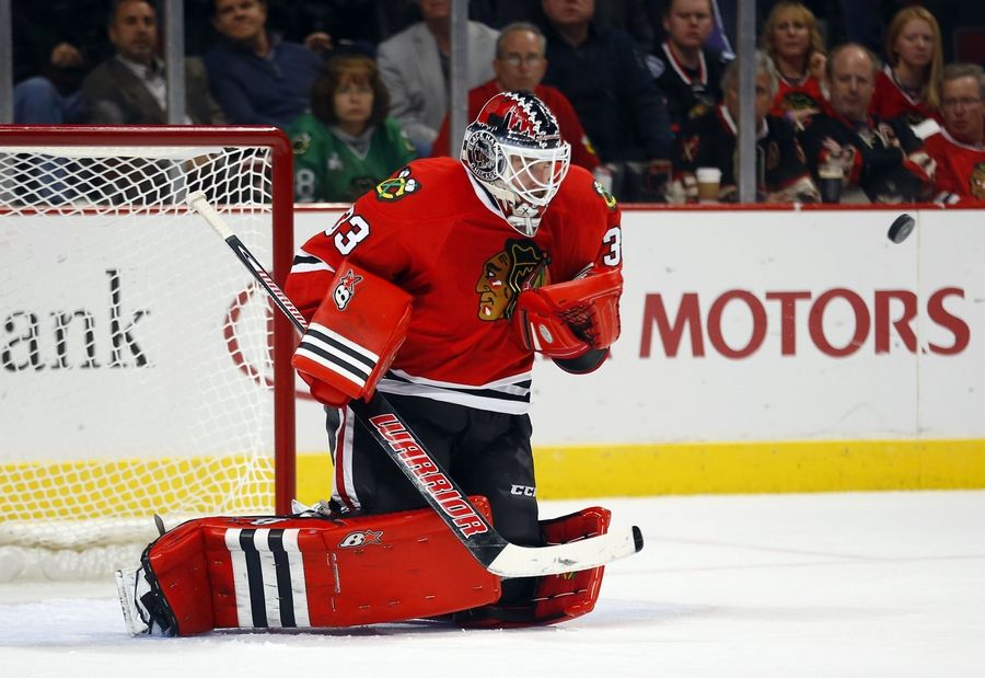 Rookie goalie Scott Darling was called up from Rockford on Sunday, signed a two-year contract extension and will start today when the Hawks host the Panthers at the United Center.