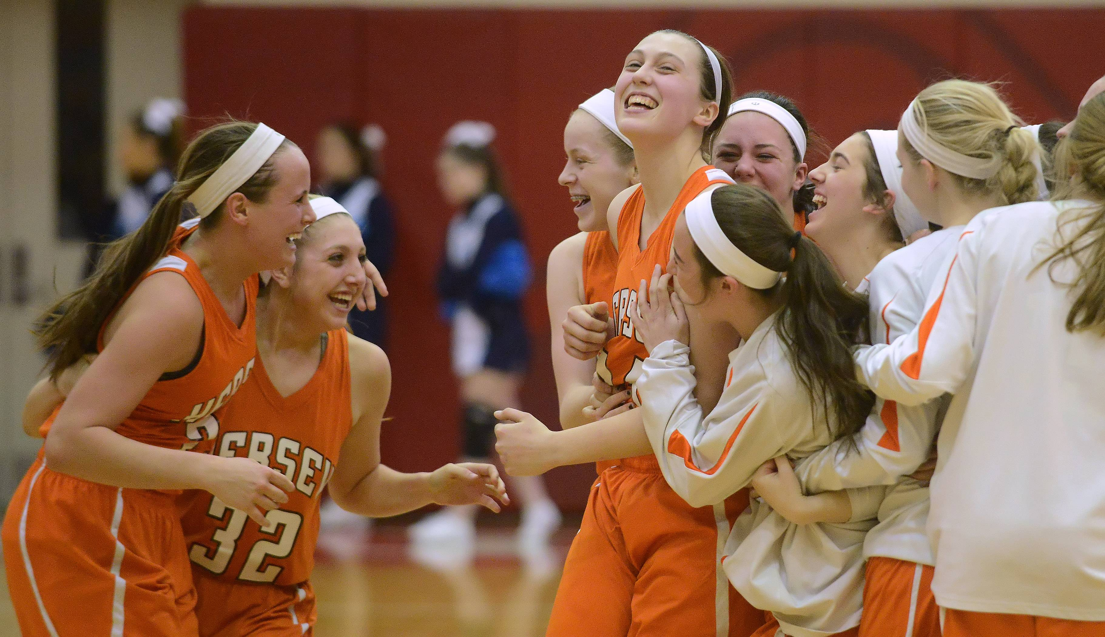 Hersey players celebrate their victory over Prospect.