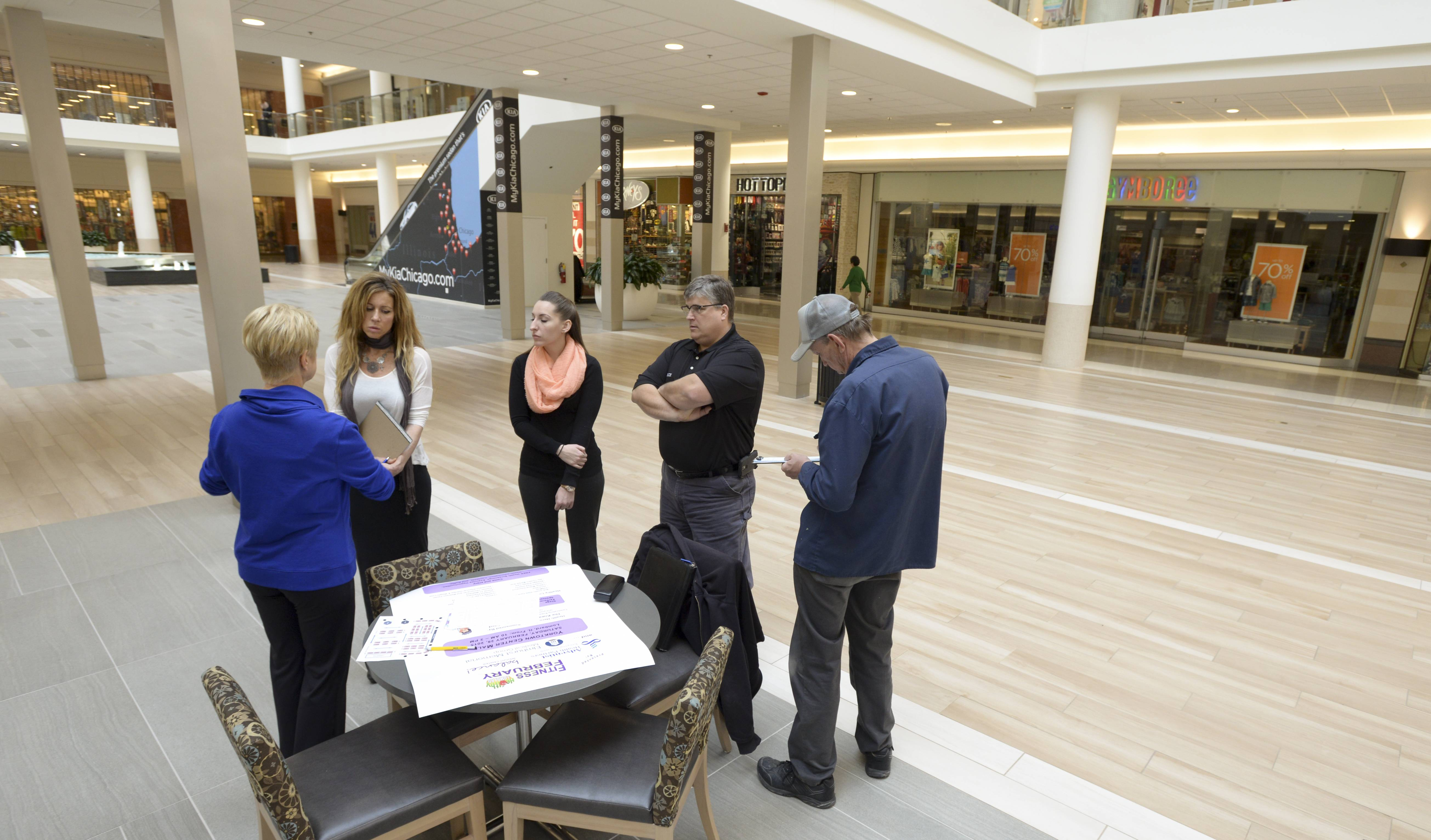 Jay Wojcik works with Yorktown Center staff on the setup of the February Fitness Fair, which will be held in the lower level center court of the mall.