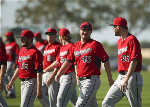 Minnesota Twins pitchers, including Phil Hughes (45) walked and jogged to warm up during a spring training workout Monday Feb. 23, 2015 in Fort Myers, Fla. (AP Photo/Star Tribune, Jeff Wheeler) ST. PAUL PIONEER PRESS OUT. MINNEAPOLIS AREA TV OUT MAGS OUT