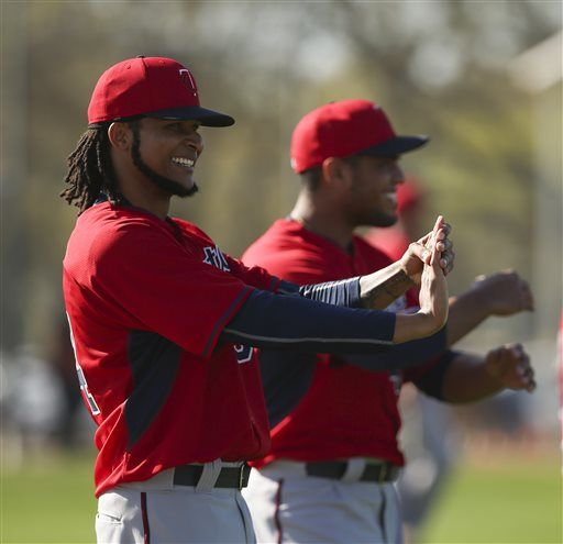 Minnesota Twins pitcher Ervin Santana stretches during a spring training workout Monday Feb. 23, 2015, in Fort Myers, Fla. (AP Photo/Star Tribune, Jeff Wheeler) ST. PAUL PIONEER PRESS OUT. MINNEAPOLIS AREA TV OUT MAGS OUT