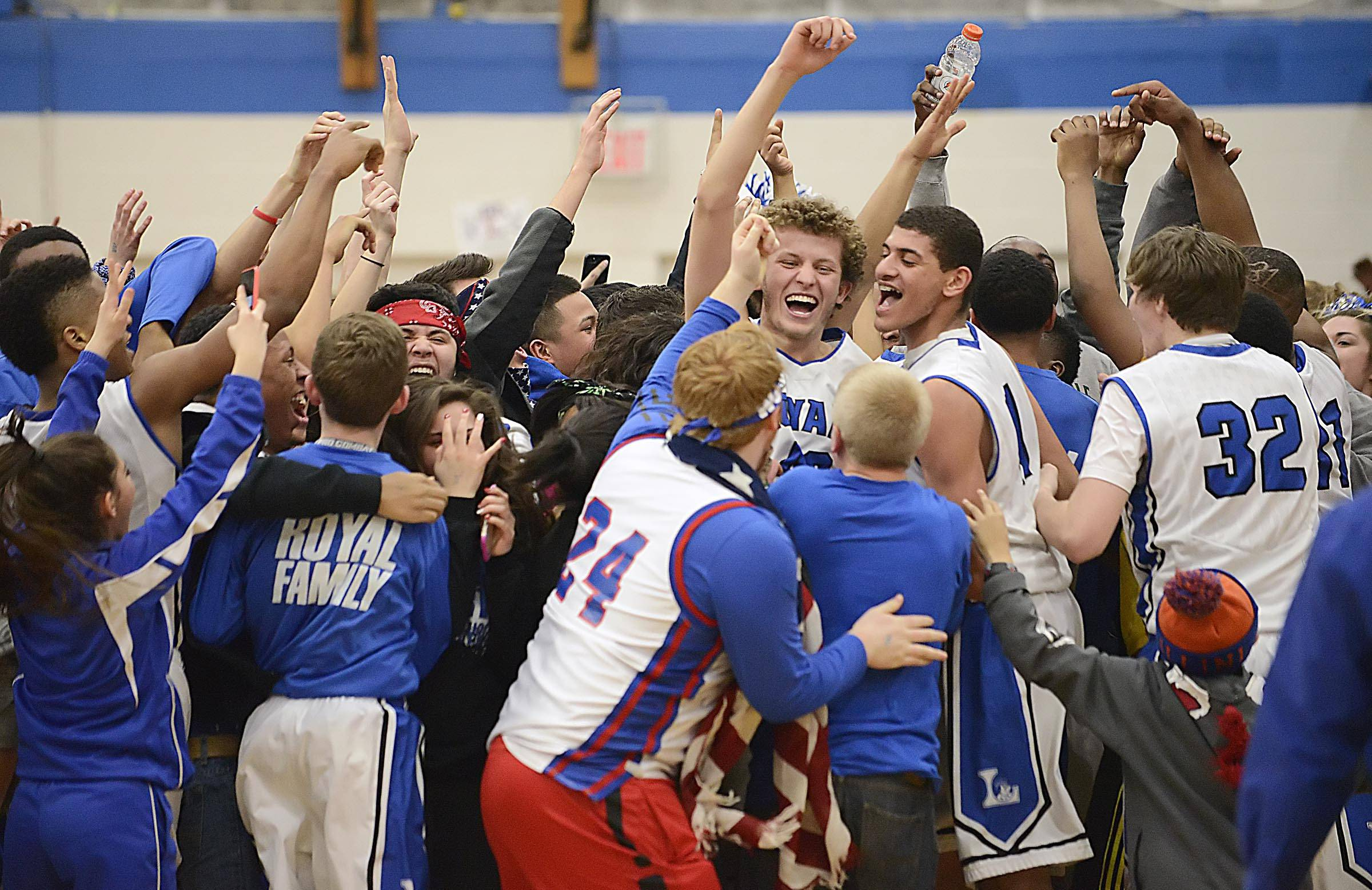 Larkin's Trenten Jackson and Christian Negron are surrounded by classmates after the Royals defeated Geneva Wednesday in Elgin.