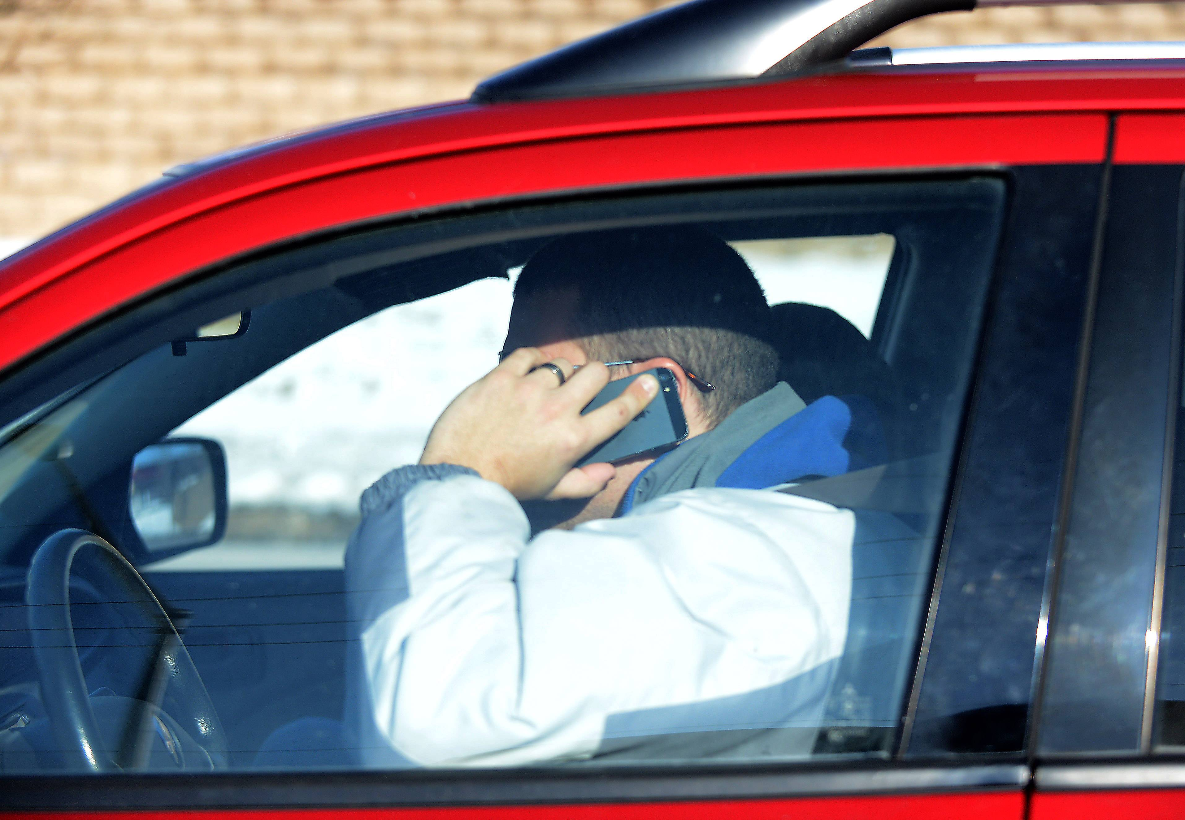 Rick West/rwest@dailyherald.com Despite it being illegal in Illinois to talk or text with a hand-held device and drive, the Daily Herald staff spotted 1,000-plus scofflaws in a hour who just couldn't break the connection addiction.