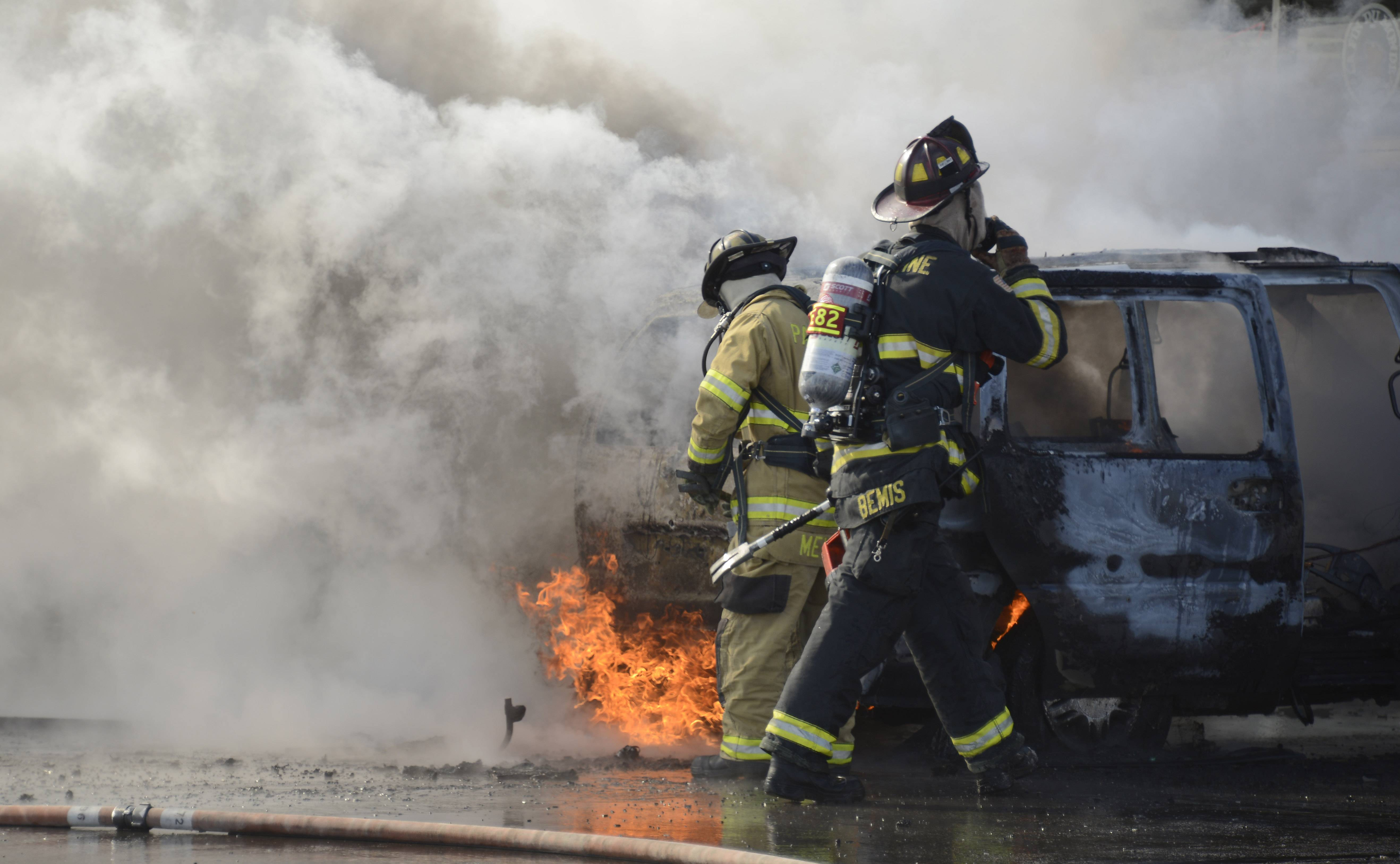 Palatine Fire Department firefighters work a van fire in a convenience store parking lot at the intersection of Rand Road and West Frontage Road. The fire did not damage the storefront.