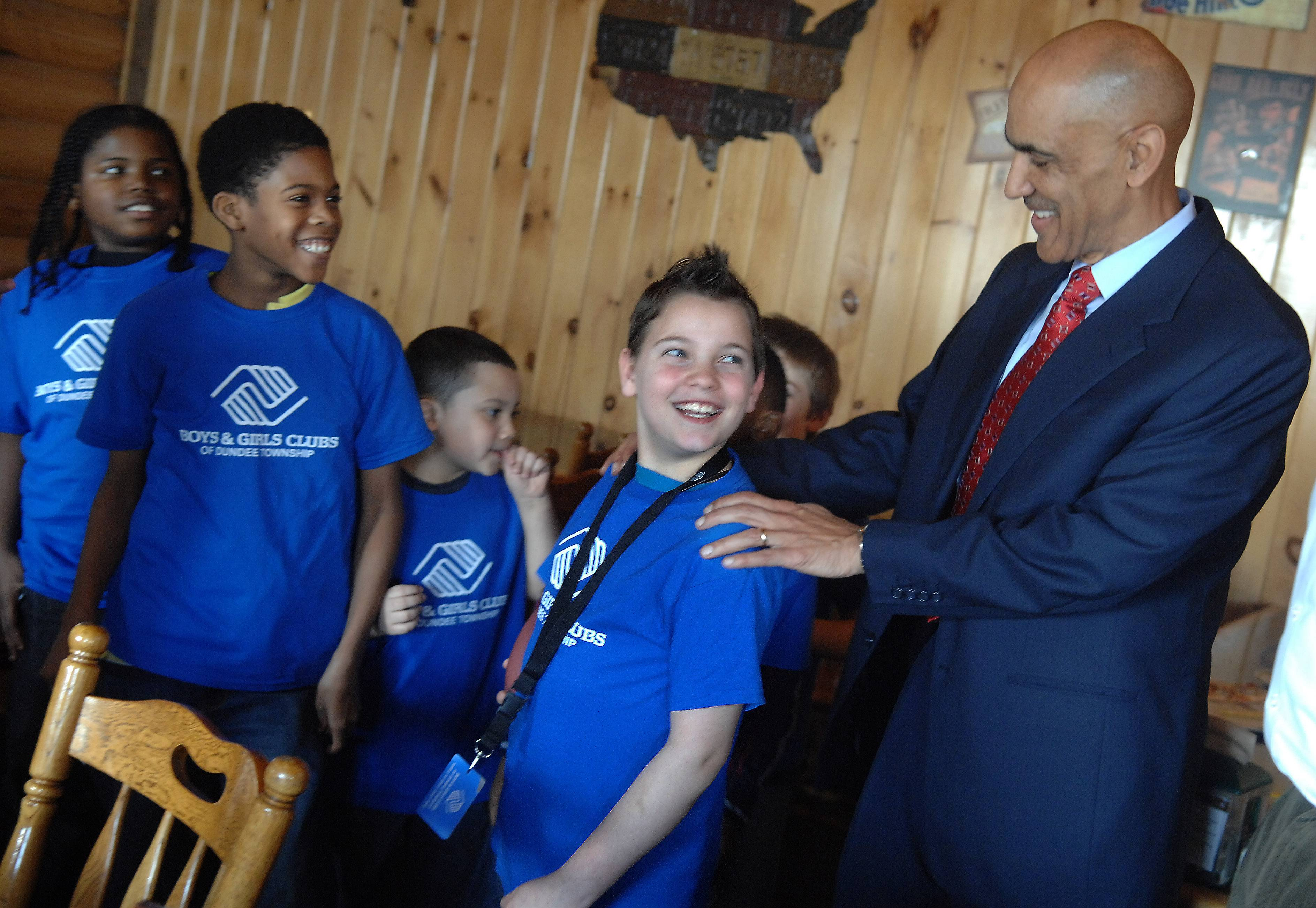 Super Bowl-winning former coach of the Indianapolis Colts Tony Dungy talks with Michael Mcwethy, 9, of Carpentersville Thursday during a meeting with Boys & Girls Clubs of Dundee Township to talk about their life experiences, the importance of teamwork and the value of school. The kids asked questions about Dungy's career after a lunch at Village Pizza in Elgin.