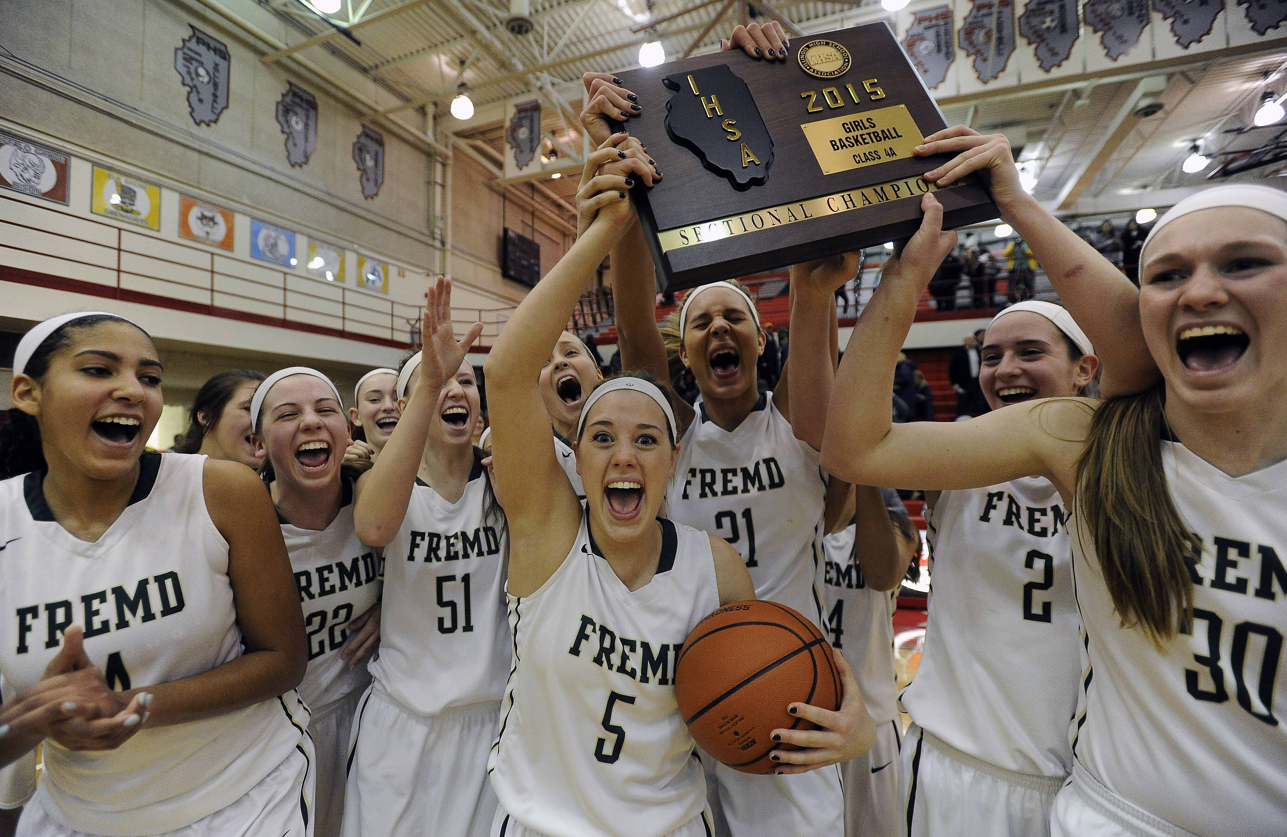 Fremd's Emily Bieda and the rest of her teammates hold up their trophy after beating Hersey in the girls Class 4A sectional championship game at Palatine High School on Thursday.