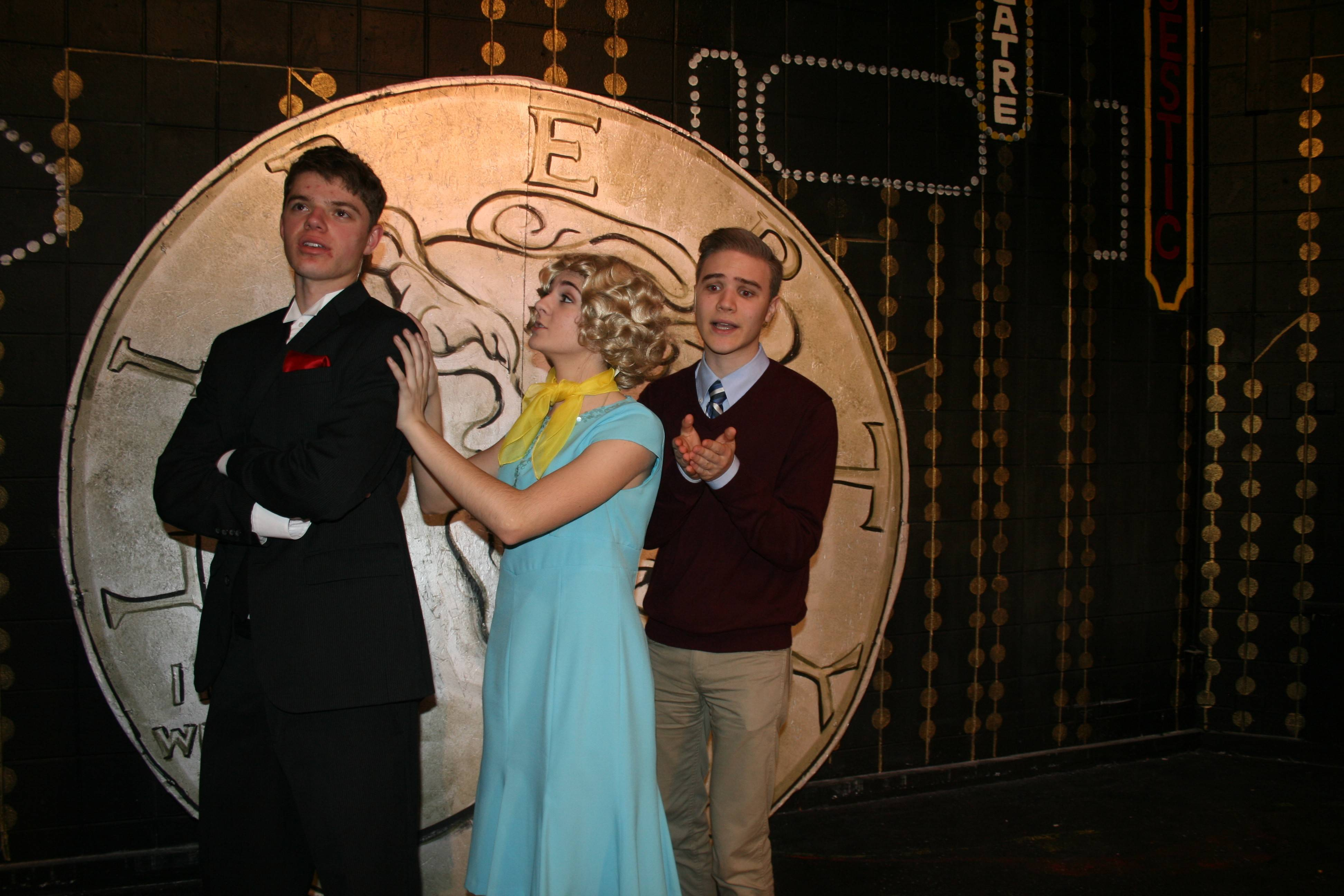 "Ben Hyde, left, Hannah Lullo and Jonathan Meir rehearse for Conant High School's production of ""42nd Street,"" which opens at 7 tonight at the Hoffman Estates school."
