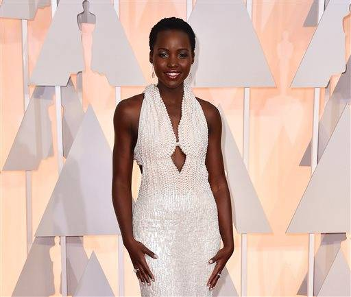 "FILE - In this Sunday, Feb. 22, 2015 file photo, Lupita Nyong'o arrives at the Oscars at the Dolby Theatre in Los Angeles. Los Angeles sheriff's spokeswoman Nicole Nishida said on Friday, Feb. 27, 2015, that deputies have recovered a dress that ""greatly resembles"" the $150,000 custom Calvin Klein dress reported stolen from Nyong'o's hotel room earlier this week. (Photo by Jordan Strauss/Invision/AP, File)"