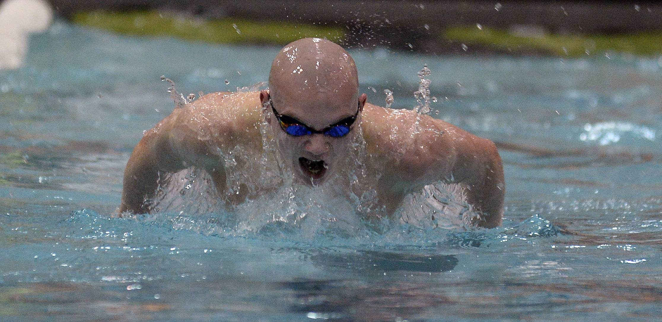 Mitchell Milosch of St. Charles East powers ahead in the 100-yard butterfly.