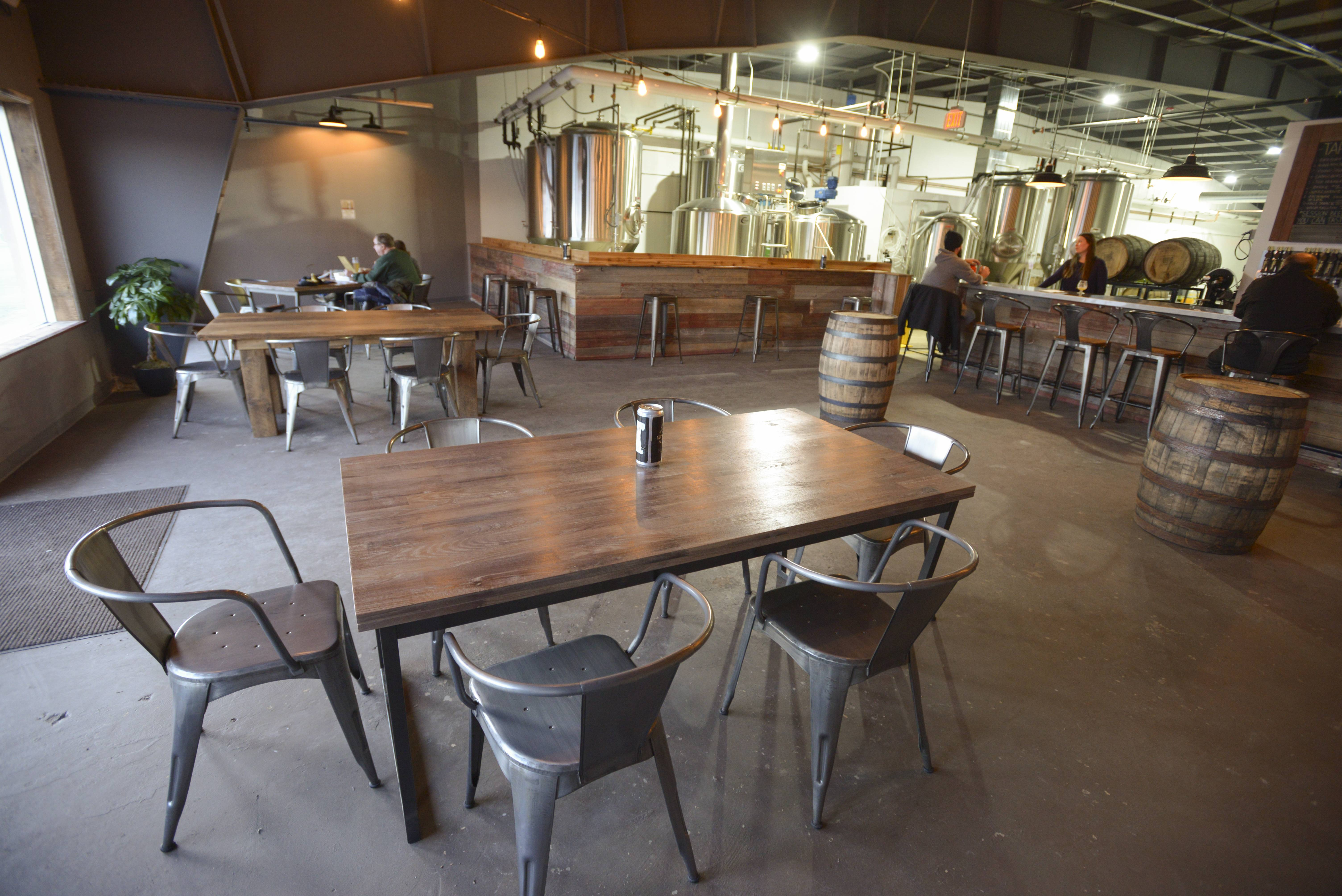 Noon Whistle Brewing in Lombard has a few tables in its large standing area.