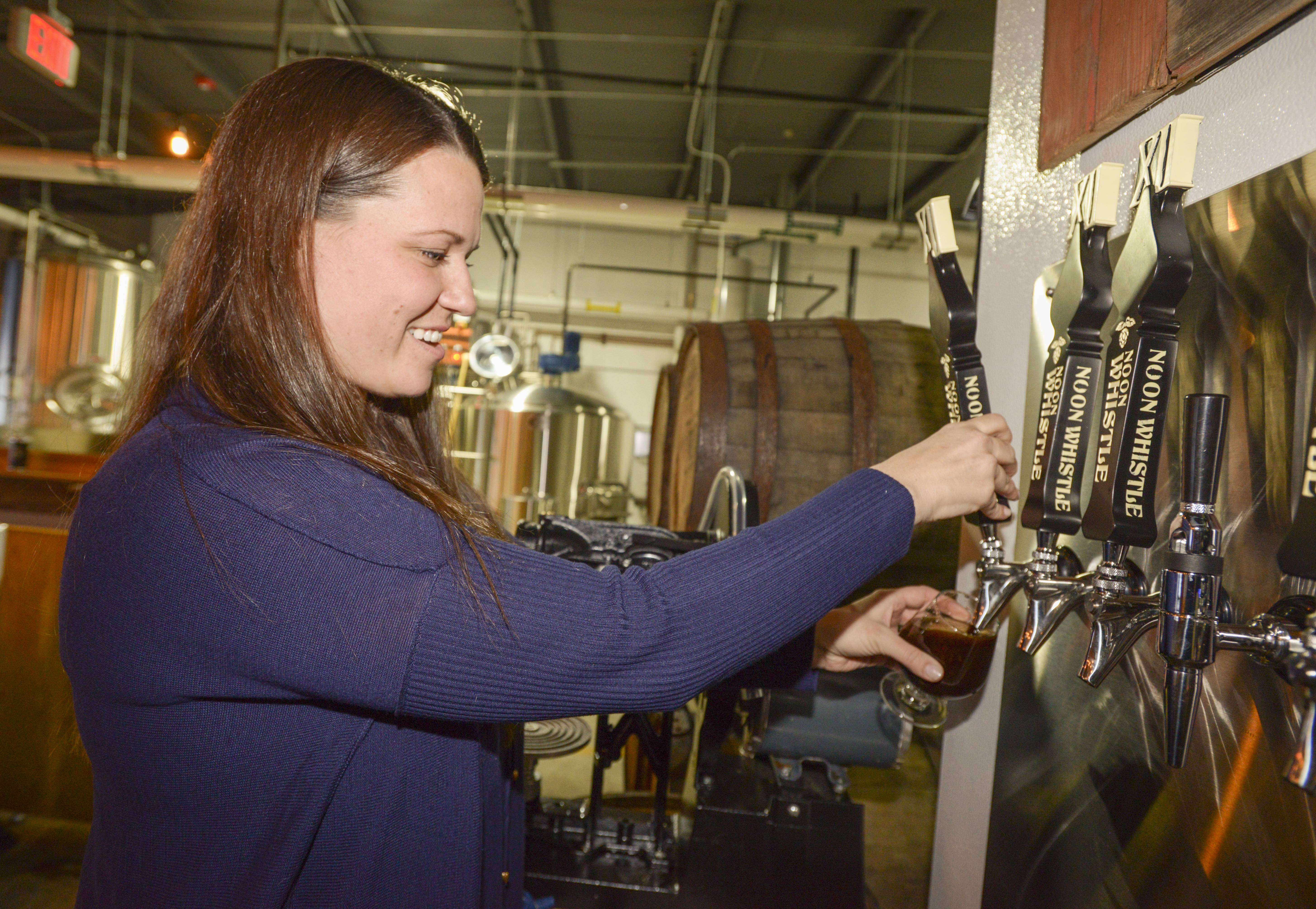 Mary Kreiner pours a High Falutin at Noon Whistle Brewing in Lombard.