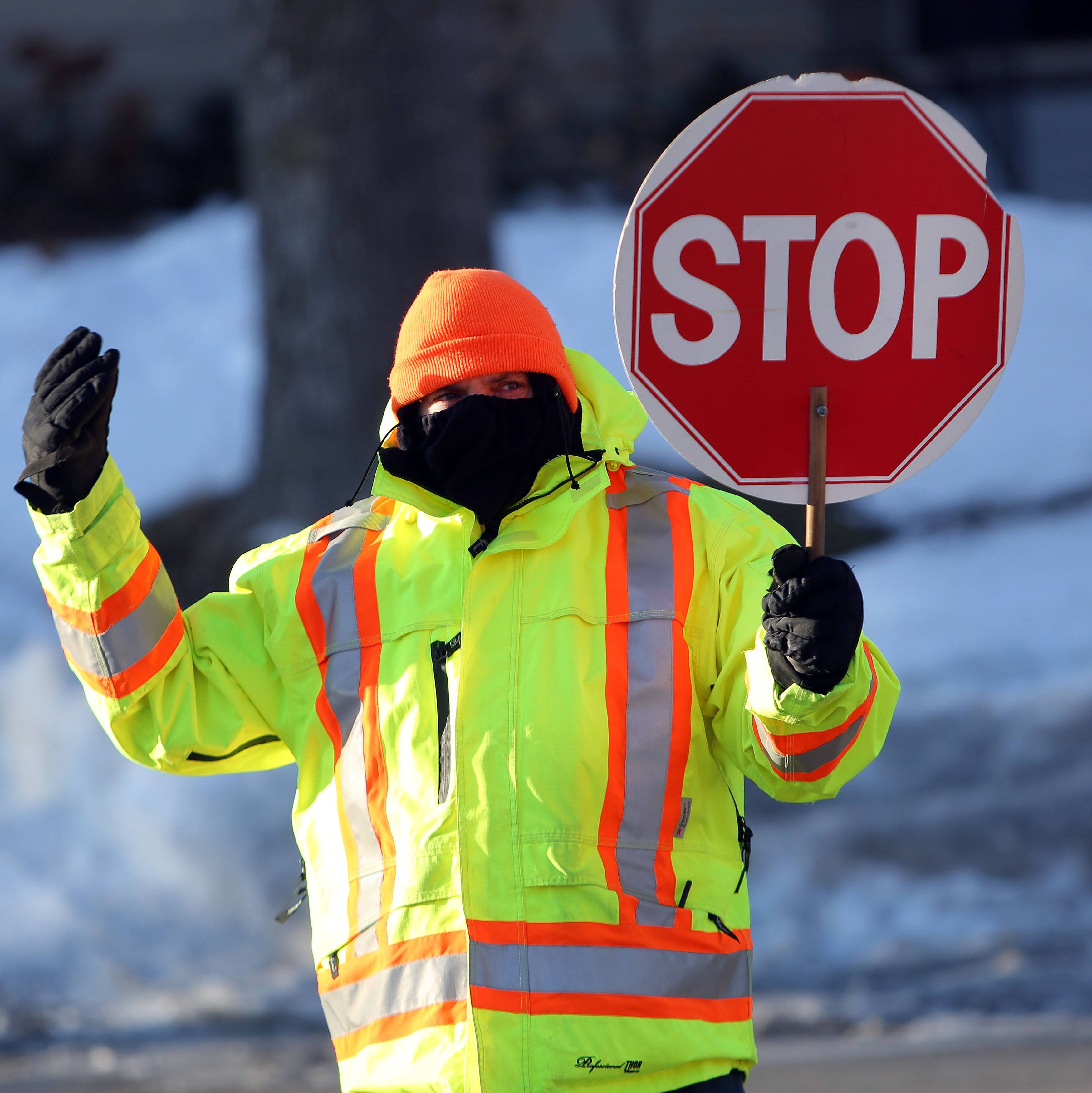 Rockland Elementary School custodian Angelo Buttitta is bundled up while directing traffic as temperatures dipped into the single digits earlier this month in Libertyville.