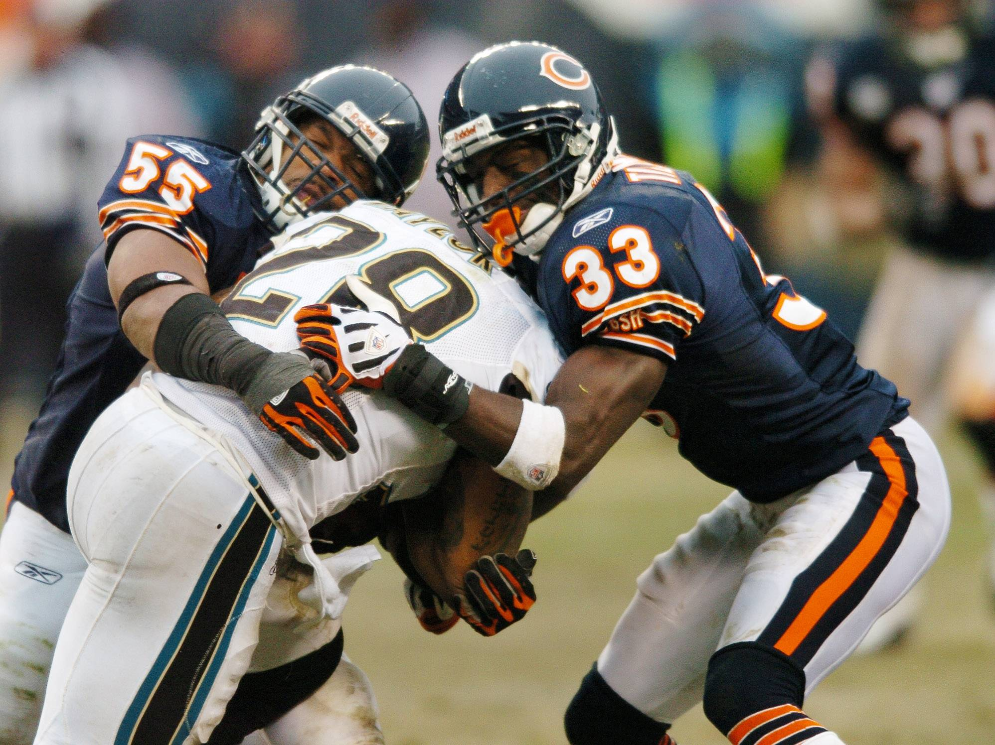With injuries piling up in the last two seasons, Lance Briggs, left, and Charles Tillman are not likely to return to the Bears without a significant salary cut.