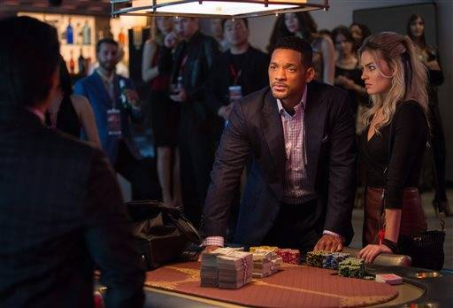 "Will Smith, center, and Margot Robbie star in ""Focus."""