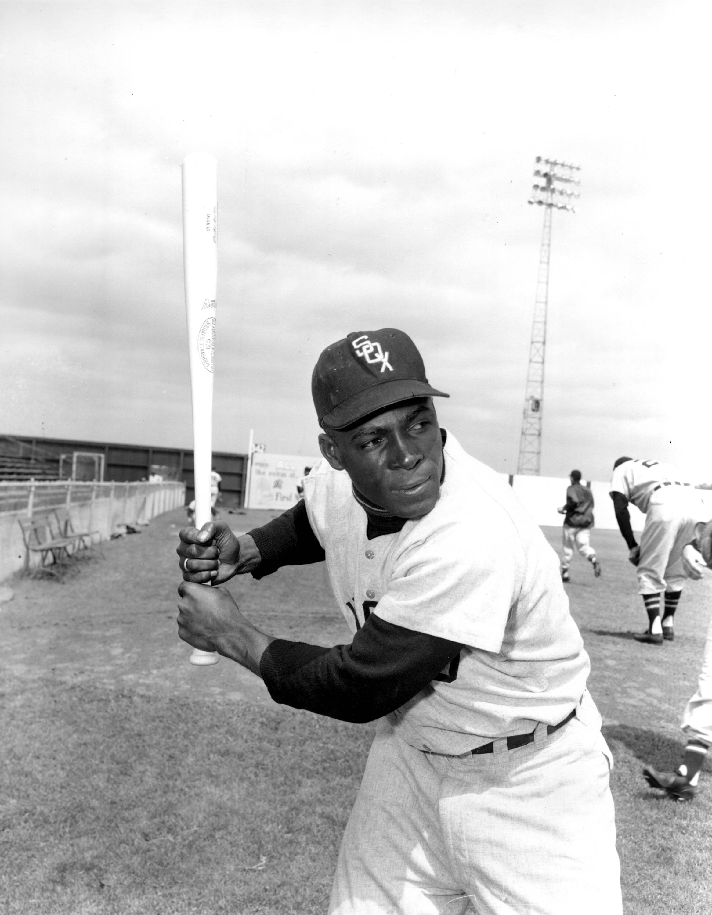 "FILE — In a March 9, 1957 file photo, Chicago White Sox outfielder Orestes ""Minnie"" Minoso poses in batting position at Al Lopez Field in Tampa, Fla. Major league baseball's first black player in Chicago, Minnie Minoso, has died. The Cook County medical examiner confirmed his death Sunday, March 1, 2015. There is some question about his age but the White Sox say he was 92."