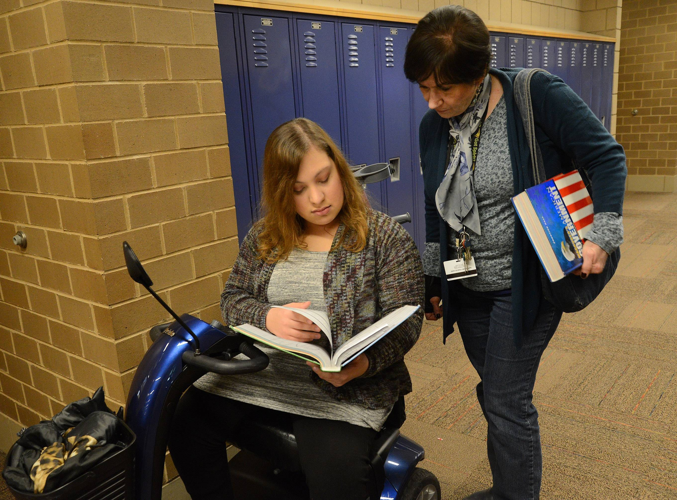 Stevenson High School student Gina Baran works with aide Inga Buttelmann. As a student with special education needs, Baran has an individualized education plan.